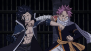 Natsu and Gray punch each other