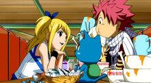 Lucy paga uma almoço para Natsu e Happy