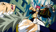 Natsu punches the Twin Dragons