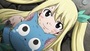 Lucy and Happy welcome Natsu