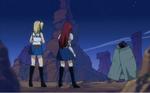 Erza y Lucy Frente al Hombre Lagarto de Daphne