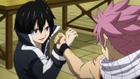 Natsu and Zeref exchange blows