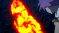Natsu watches the destruction