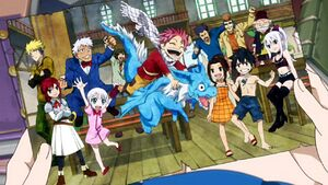 Lucy holding a picture of the young Fairy Tail Mages