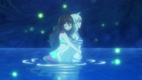 Zera hugs Mavis in the lake