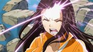 Runes being written on Cana's forehead