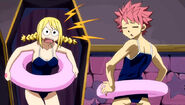 Lucy and Natsu in matching swimsuits