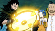 Gajeel and co see the Clock Part glow