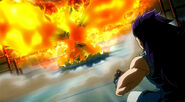 Natsu appears in front of Gajeel covered by his Flames