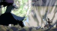 Natsu deflects Gajeel's breath attack