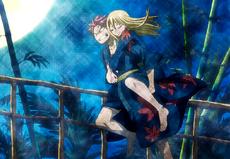 Natsu llevando a Lucy