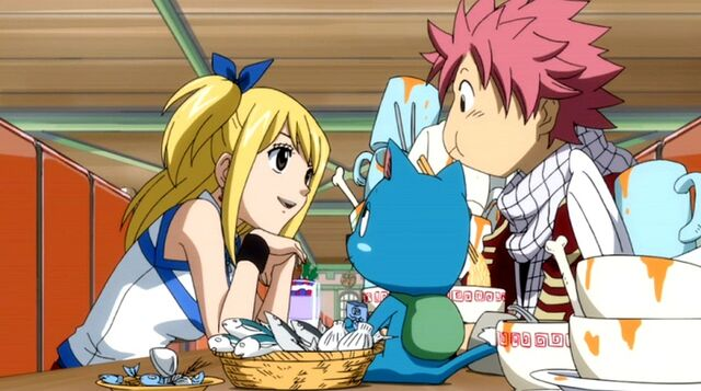 File:777px-Lucy treating Natsu and Happy to dinner.jpg