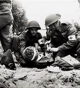 19th Battalion helping casualties.