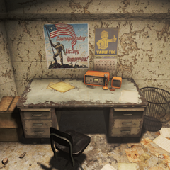 One of the desks in the bunker with a ham radio on it