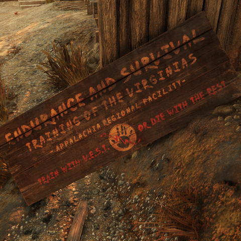 A fallen sign with Camp Venture's former name.