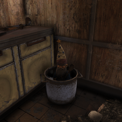 Gnome wearing clown hat in stew pot