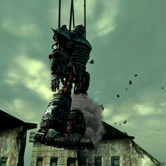 Liberty Prime crashing into a building while hoisted over the outer Citadel wall