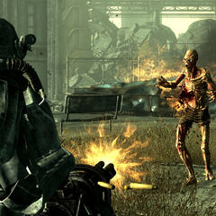 A Brotherhood of Steel paladin shooting a feral ghoul with a minigun
