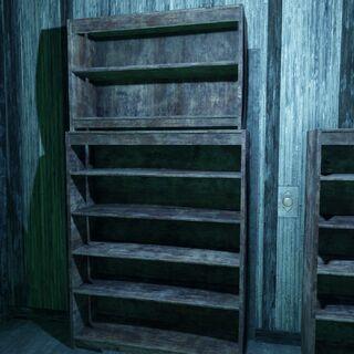 Ліфт ховається за книжковою шафою. Зверніть увагу на кнопку праворуч