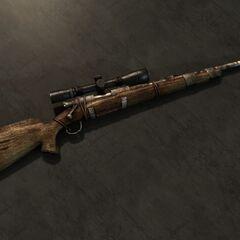 Мисливська гвинтівка з встановленим оптичним прицілом.