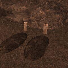 Могили позаду будиночків