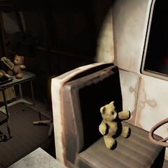 A teddy bear sits in the drivers seat while another performs surgery in the back in the tunnels