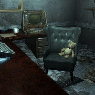Teddy bear sitting on chair