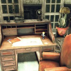 Potential Vault-Tec bobblehead, top floor inside Paladin Taggerdy's room
