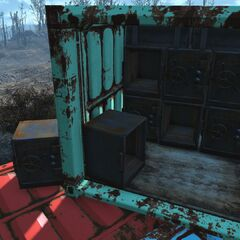 Multiple safes on a barge carrying cargo containers.