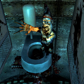 Пошкоджений гном в туалеті <a href=