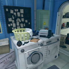Player character's quarters laundry room with a storage area to the right and shower to the left