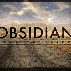 Логотип розроблювача на тлі скріншота з гри, з видом на гори зробленого з дороги, неподалік від <a href=