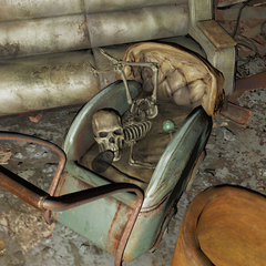 Small skeleton with a full sized skull in a crib