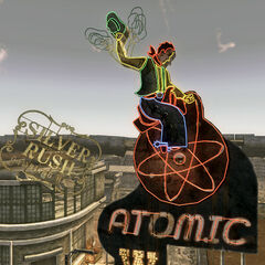Atomic Wrangler sign with Silver Rush in background