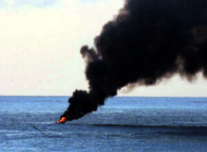 US Navy 060318-N-8623S-003 A suspected pirate vessel ignites in flames before burning to the waterline
