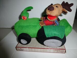 Animated Deer in Green Tractor Plays Grandma Got Run Over By A Reindeer New