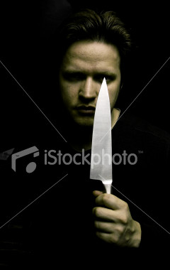 Stock-photo-378230-portrait-of-man-holding-knife-blade-low-key