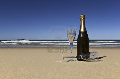 13617005-bottle-of-champagne-with-two-crystals-glasses-on-a-secluded-beach