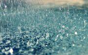 Foto-van-een-plas-water-met-regendruppels-hd-regen-wallpaper