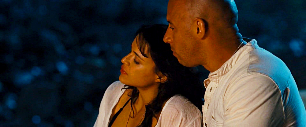 Dominic and Letty relax on the beach after the success of their latest job.