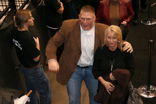 Lesnar (with wife Rena) was out for months with Diverticulitis