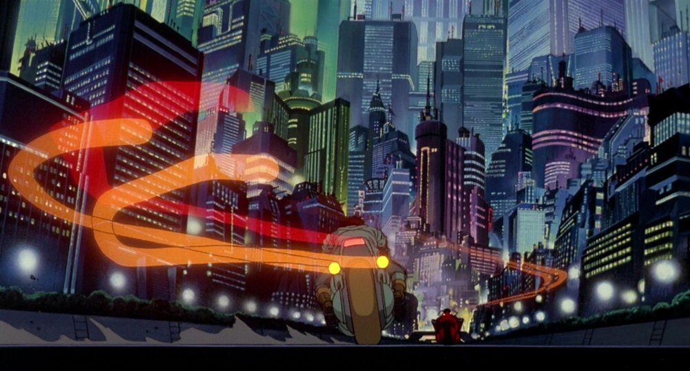 Neo-Tokyo cityscape with motorcycles racing down the street in Akira