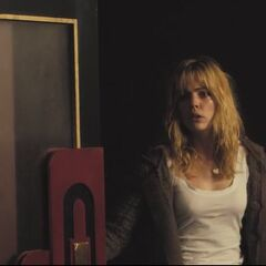 Jess enters the theater.