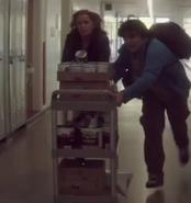 Madison and Tobias in corridor