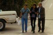 Liza and Daniel helping Ofelia
