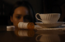 Alicia sees the empty pill bottle