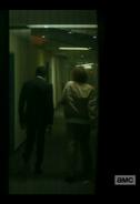 Strand and Nick make their way along a corridor