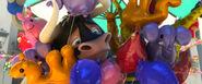 Ferdinand Smiling Behind Balloons