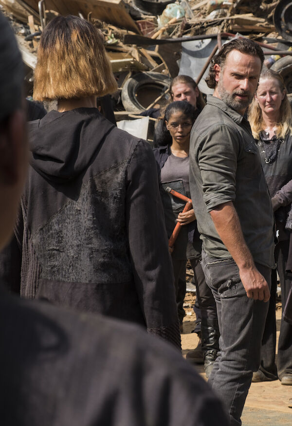 Rick Grimes is surrounded by The Walking Dead junkyard gang.