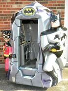Batman and Robin batcave coin-op ride